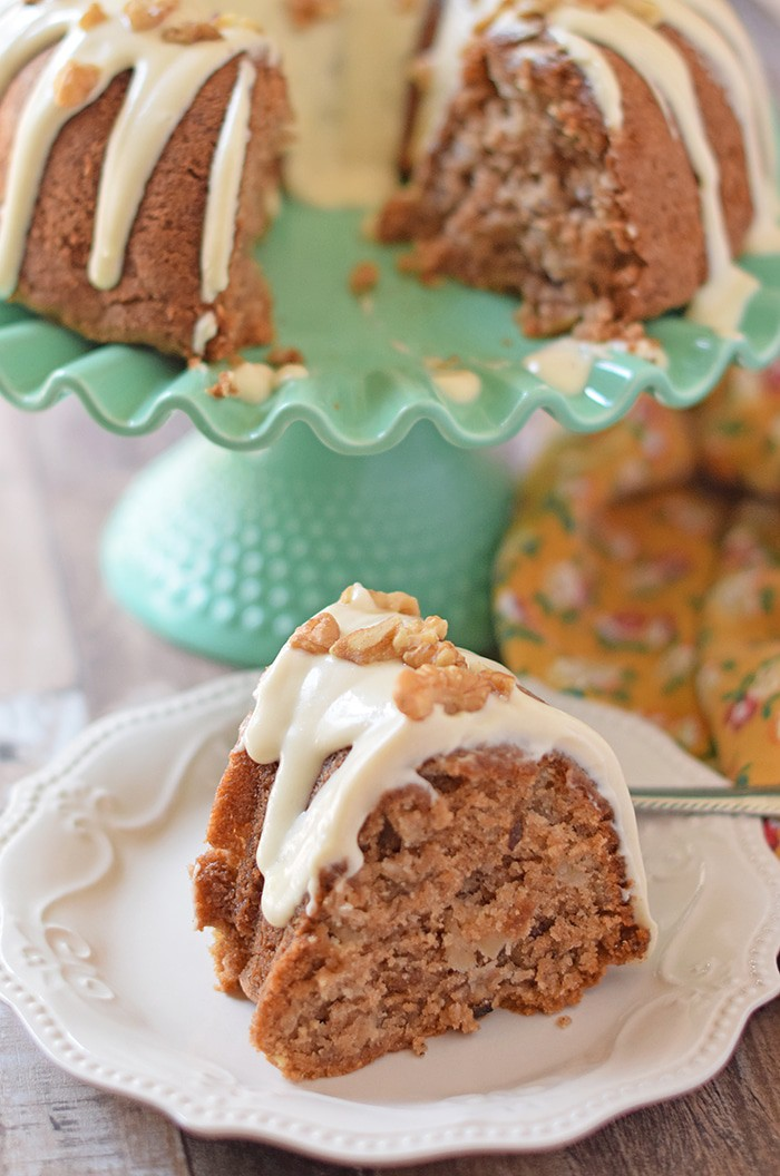 Apple Bundt Cake is an old fashioned cake recipe made with apples, cinnamon, walnuts, and a caramel cream cheese glaze. Makes a scrumptious fall and holiday dessert!