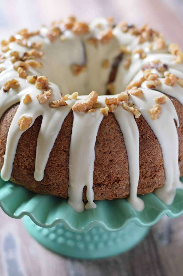 Apple Bundt Cake, a scrumptious cake recipe with apples, cinnamon, walnuts, and a caramel cream cheese glaze. Makes a delicious fall and holiday dessert!