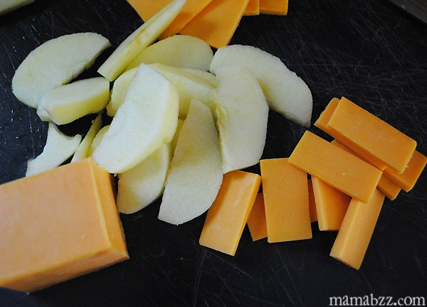 Slice up apples and cheese for appetizers
