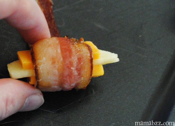 Wrap apples and cheese in bacon