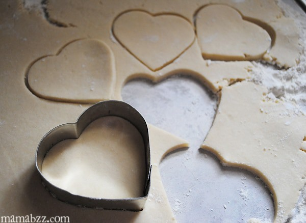 Cut heart shapes in cookie dough