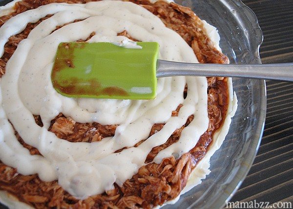 Spread Ranch dressing on top of barbecue mixture