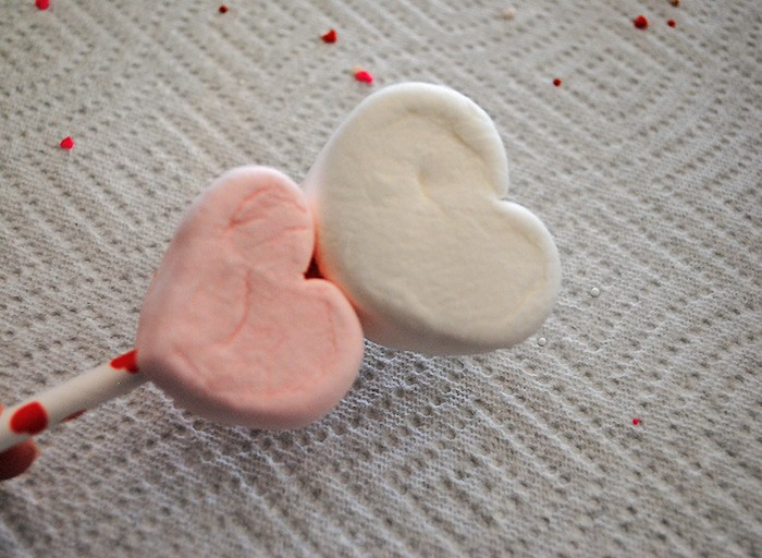Use heart shaped marshmallows, Jet-Puffed marshmallows, paper straws, candy melts, and sprinkles to make yummy Valentine Marshmallow Pops. They're a scrumptious Valentine's Day craft or Valentine party idea, and kids love decorating these fun and easy treats. Grab the supply list and instructions.