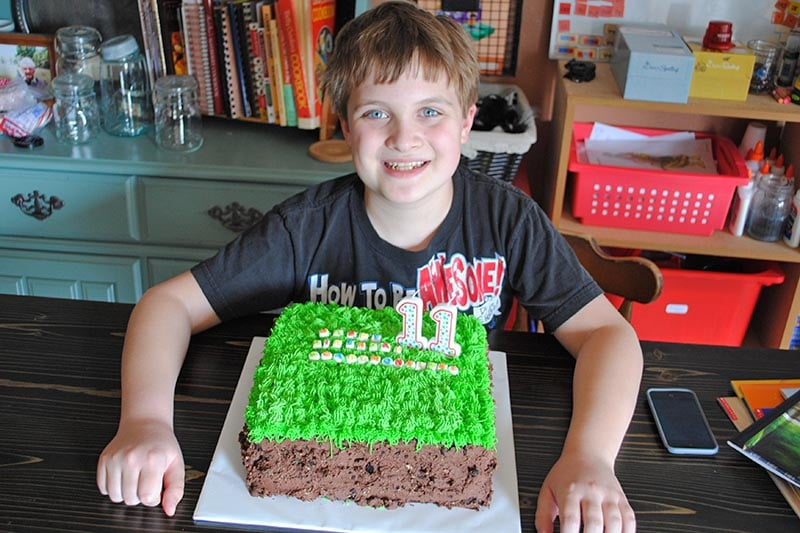 boy child with Minecraft birthday cake