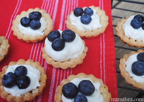 Add blueberries to tarts