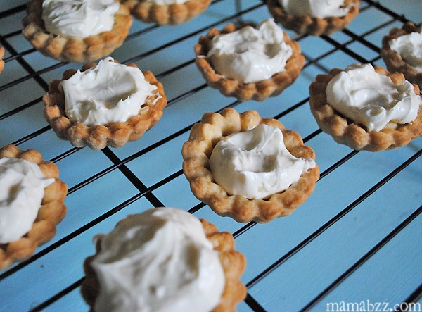Add cream cheese filling to tarts