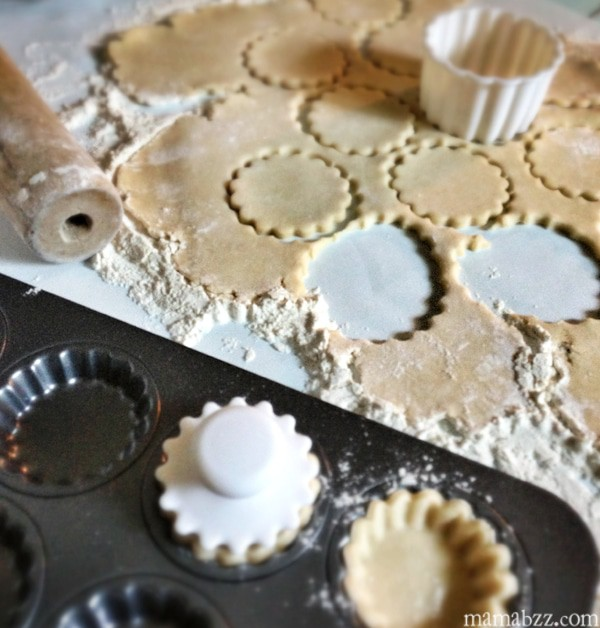 Cut dough crusts out for tarts