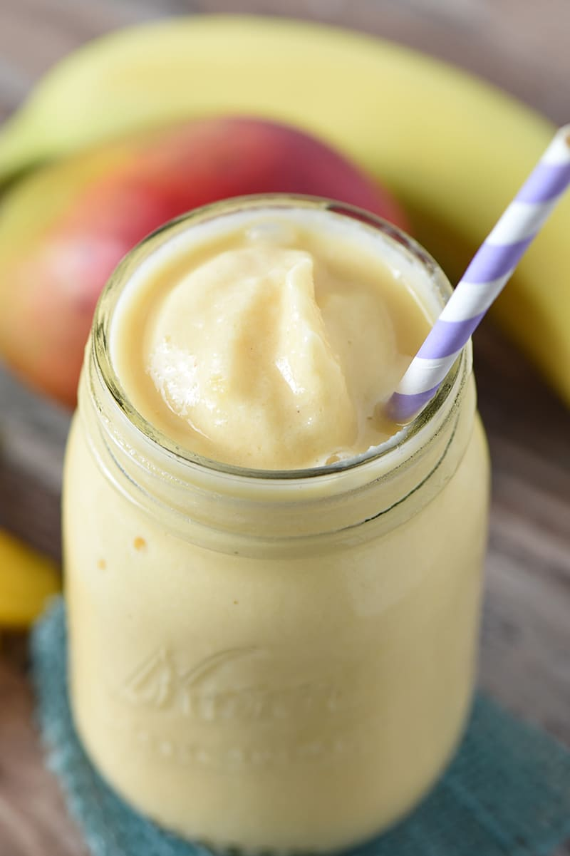 Peach Mango Smoothie that's easy to make and makes a delicious snack or morning addition to breakfast. 6 ingredients make a healthy snack my kids and I all love!