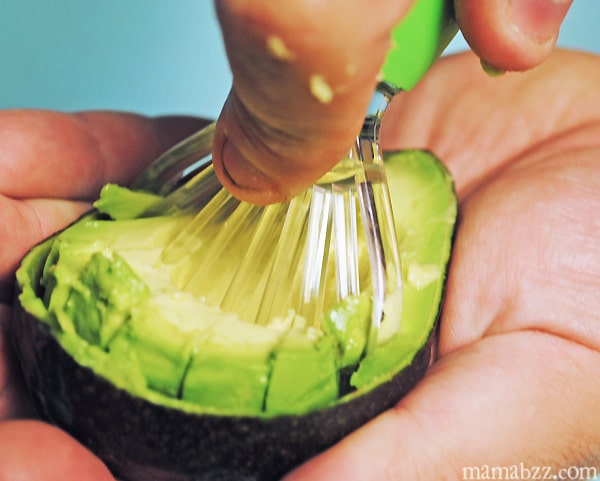 Slicing up the avocado with the Good Cook Avocado Slicer