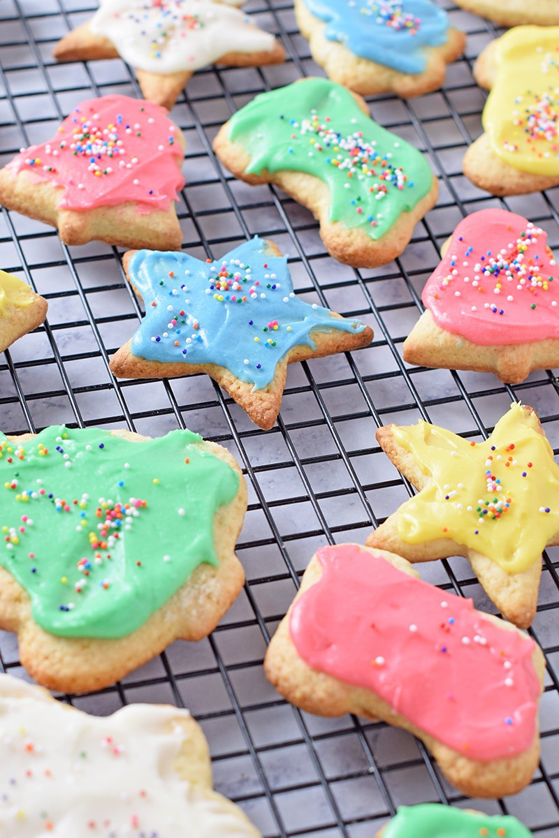 How to make Crisp Cutout Sugar Cookies, a delicious holiday sweet treat. Top them off with homemade icing and sprinkles. One of our favorite Christmas season activities.