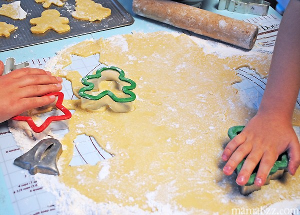 Cut out sugar cookies using holiday cookie cutters