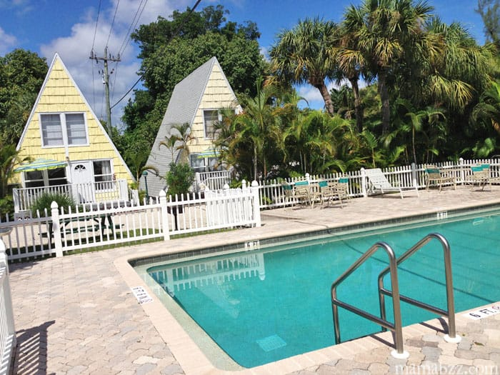Swimming pool with cottages in background at Anchor Inn of Sanibel