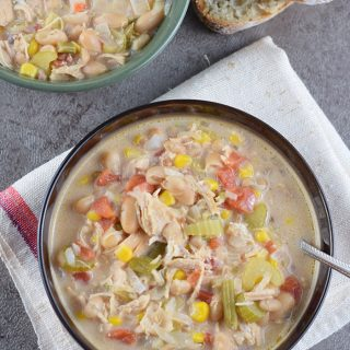 How to make a delicious White Chicken Chili in the slow cooker for an easy family meal. Filled with vegetables, white beans, chicken, green chiles, and cheese.