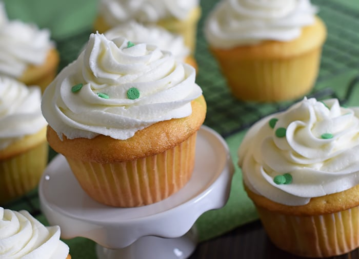 Jello cake (or poke cake) has always been one of my favorites. Learn how to make Lime Vanilla Poke Cake Cupcakes with buttercream frosting. These scrumptious cupcakes bring just a hint of green for a festive St Patricks Day or any day really.