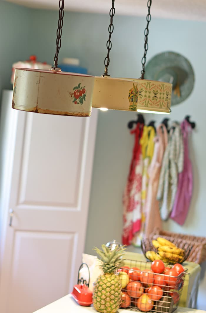 create a farmhouse kitchen look with diy light fixtures upcycled from vintage cake tins how antique kitchen lighting fixtures