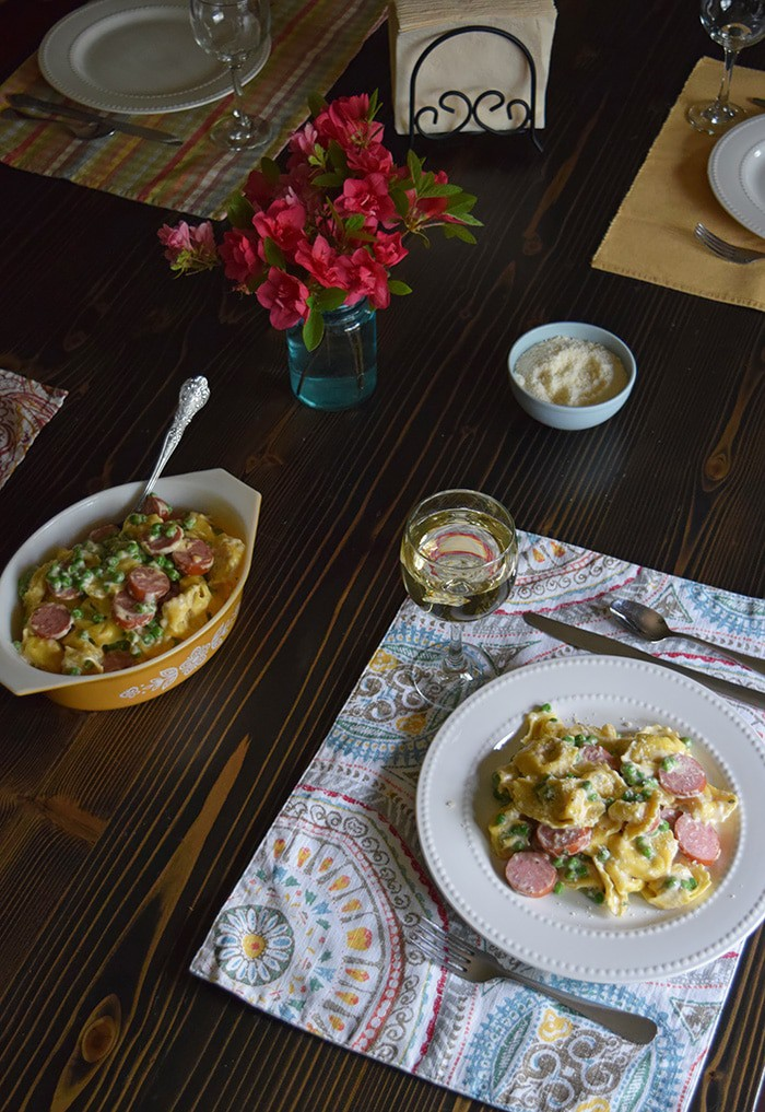 Bring your family back to the dinner table with a spring inspired, Tuscany inspired recipe for Creamy Tortellini Alfredo, a simple family dinner recipe that takes very little time to make, giving you more time with the ones you love. And don't forget to add a few special touches to the table; after all, it's the little things in life that are worth celebrating.