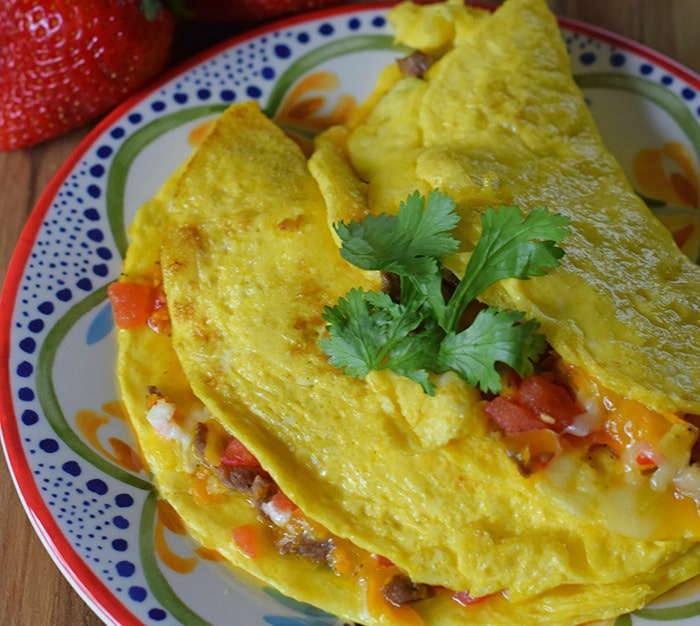 An omelette breakfast is a family favorite. How to make Tex-Mex omelettes using tenderloin tips, vegetables, and cheeses. Breakfast just got tastier than ever.