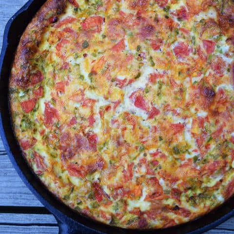 Cheesy Baked Frittata with Ham, Peppers, and Tomatoes