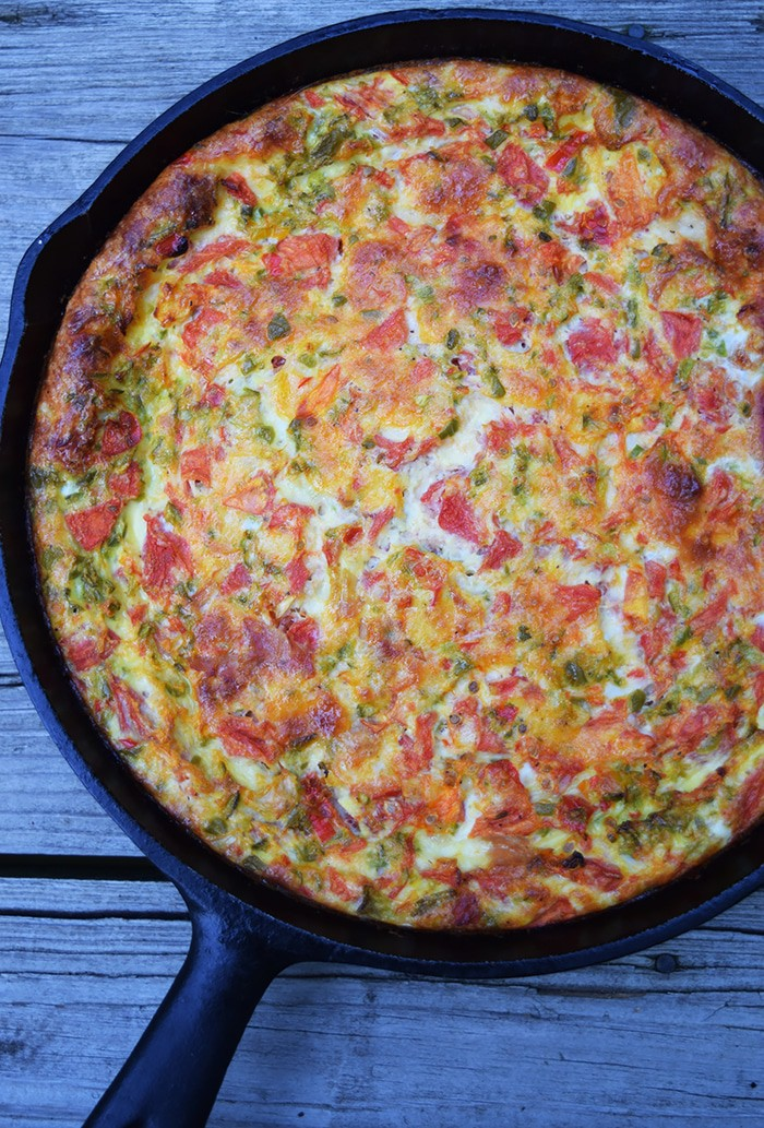 A cheesy baked frittata with ham, peppers, and tomatoes makes the perfect breakfast, brunch, or dinner recipe. Eggs are my go to healthy food, especially when I'm out of ideas or whenever I'm just not feelin' what's planned on the menu.