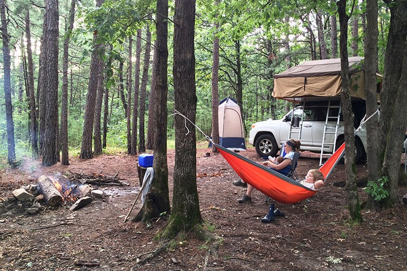 camping tips for dispersed camping with family in ouachita national forest with a rooftop tent, hammock, and campfire