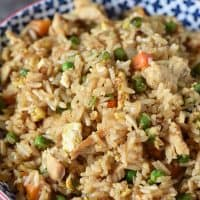 bowl of chicken fried rice with eggs and vegetables