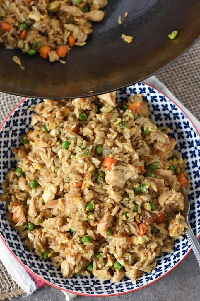 bowl and wok with homemade chicken fried rice