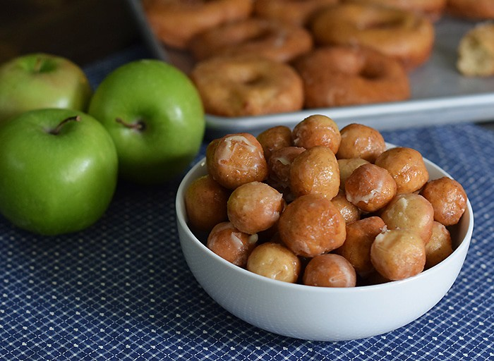 Caramel Apple Donut Holes are the perfect fall treat, coated with a Krispy Kreme copycat like icing that's flaky and oh so scrumptious.