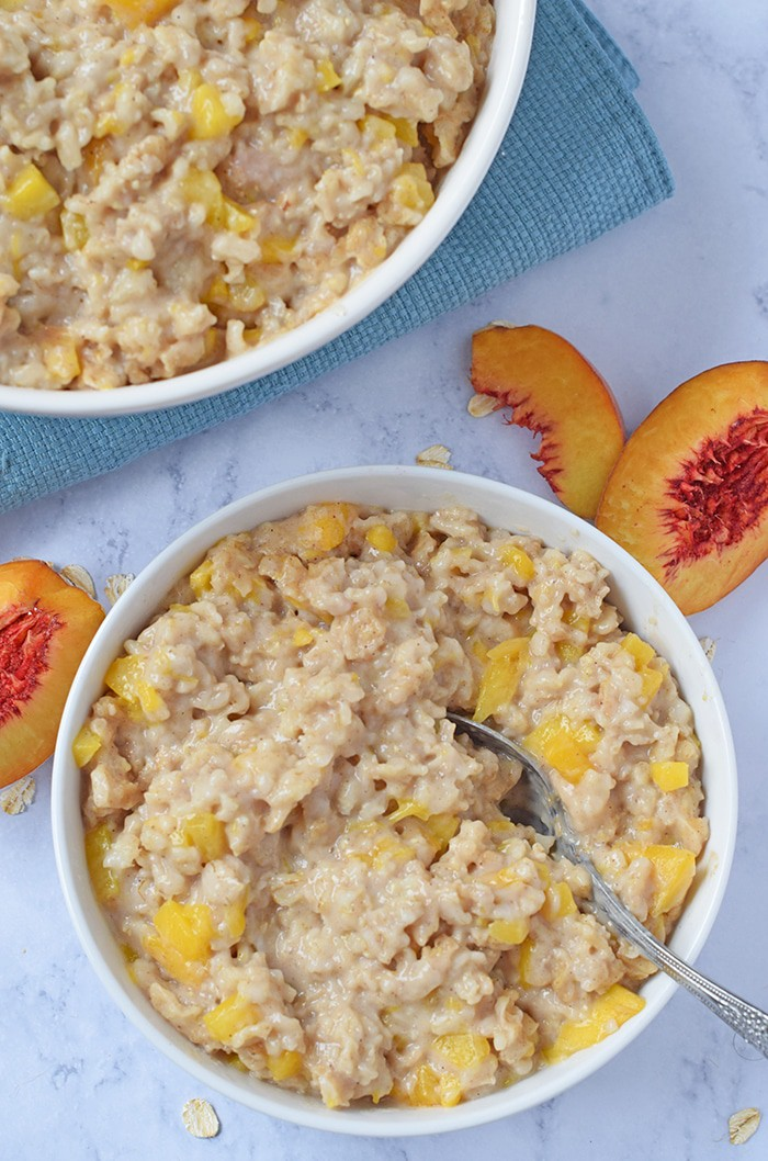 Instant Pot Peaches and Cream Oatmeal makes an easy breakfast idea you can throw together on busy mornings. Just stir together ingredients, pop on the lid, and it practically makes itself!