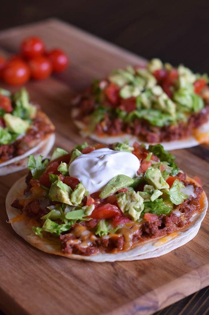 Homemade is way better, especially when it comes to Homemade Mexican Pizza with All the Fixin's, like lettuce, tomatoes, and avocados. Enjoy a simple recipe that makes a delicious family meal and curbs those cravings for your favorite Mexican and Tex-Mex food.