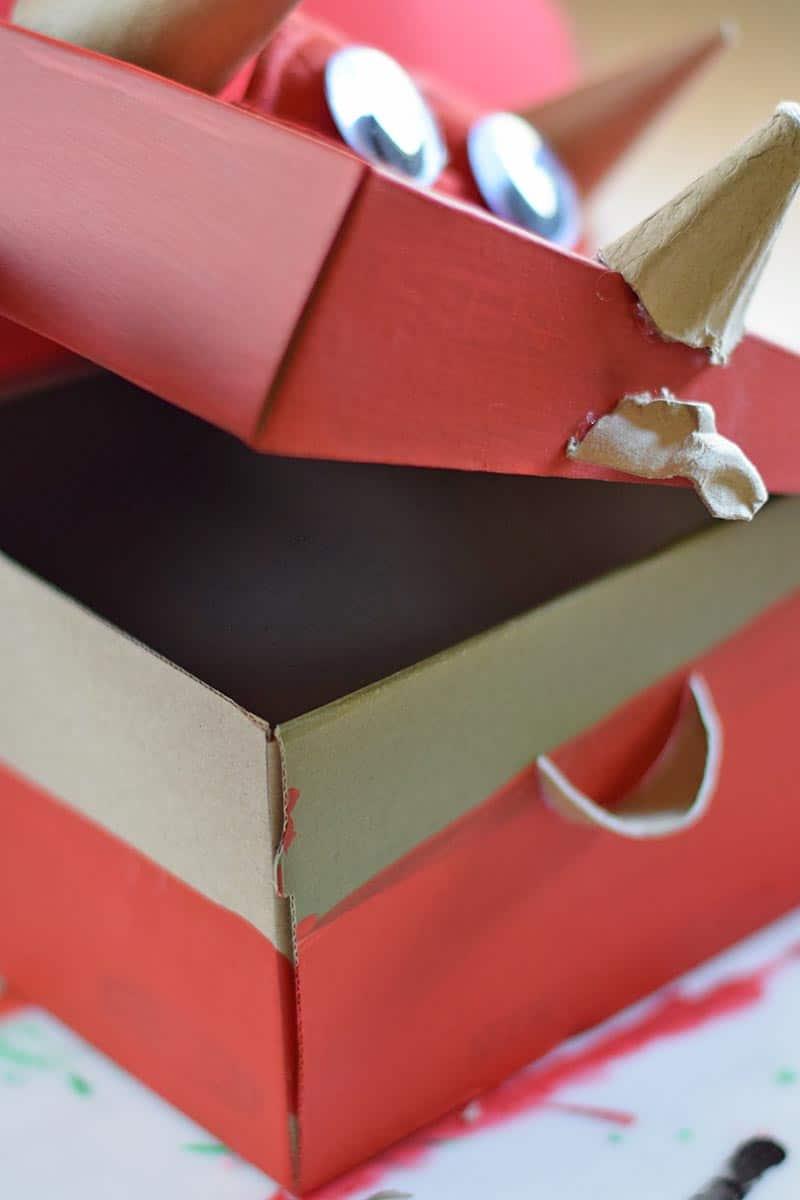 open lid of red dinosaur Valentine box