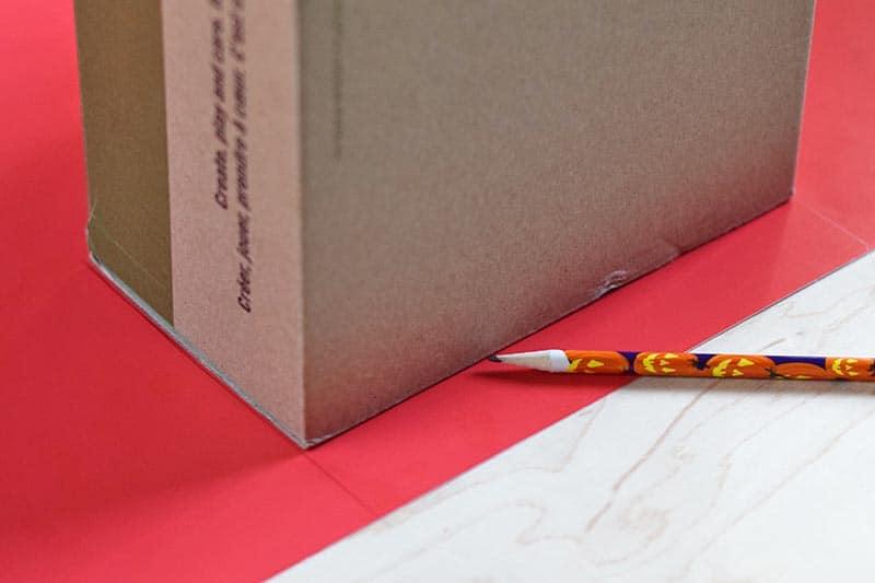 measuring shoebox for red poster board dinosaur crest