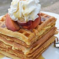 With peaches in the batter and peaches sliced on top, Peaches and Cream Waffles have a light peachy taste with a hint of cinnamon. Top them off with whipped cream and real maple syrup, and serve for a scrumptious breakfast or breakfast for dinner. Printable recipe!