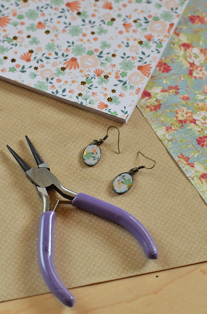Love finding Mod Podge ideas? Me too! Here's an easy tutorial for making your own DIY earrings with Mod Podge Dimensional Magic and scrapbook paper. Homemade jewelry with your own special touch!