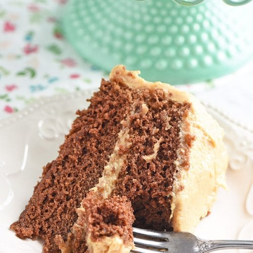 Bite out of peanut butter chocolate cake slice