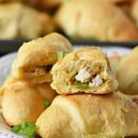leftover turkey stuffing crescent rolls with green onions on a white plate, easy party appetizers