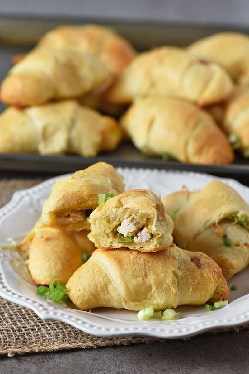 leftover turkey stuffing crescent roll appetizers on an ivory plate with cookie sheet behind