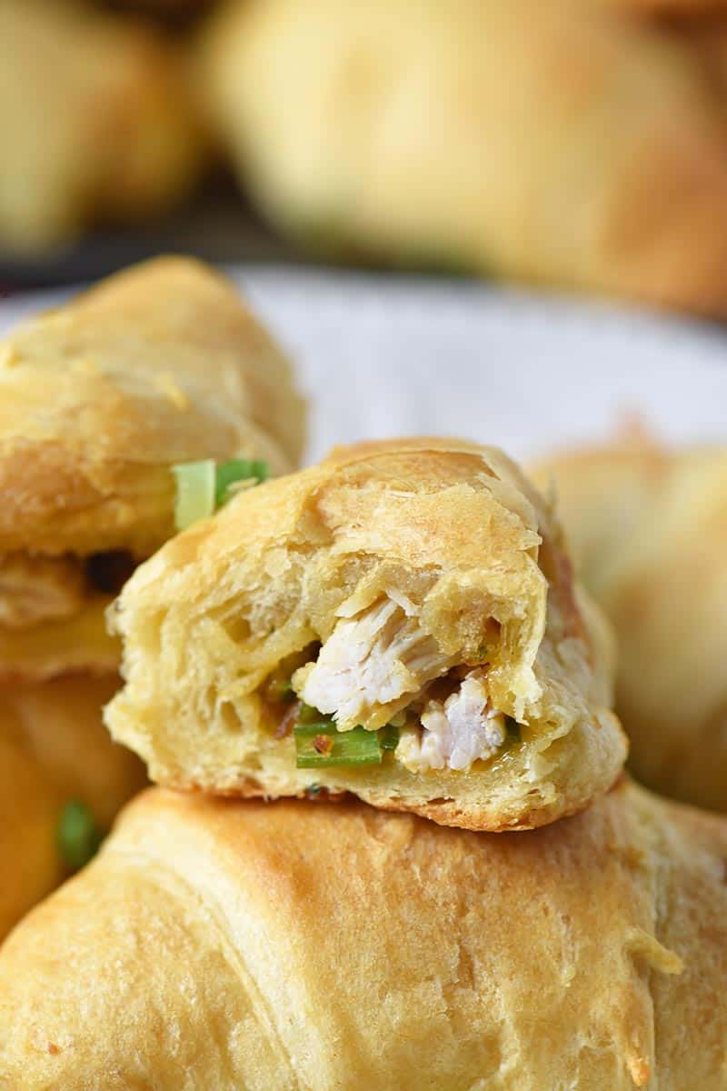 leftover turkey stuffing crescent roll sliced in half with turkey, stuffing, and green onions