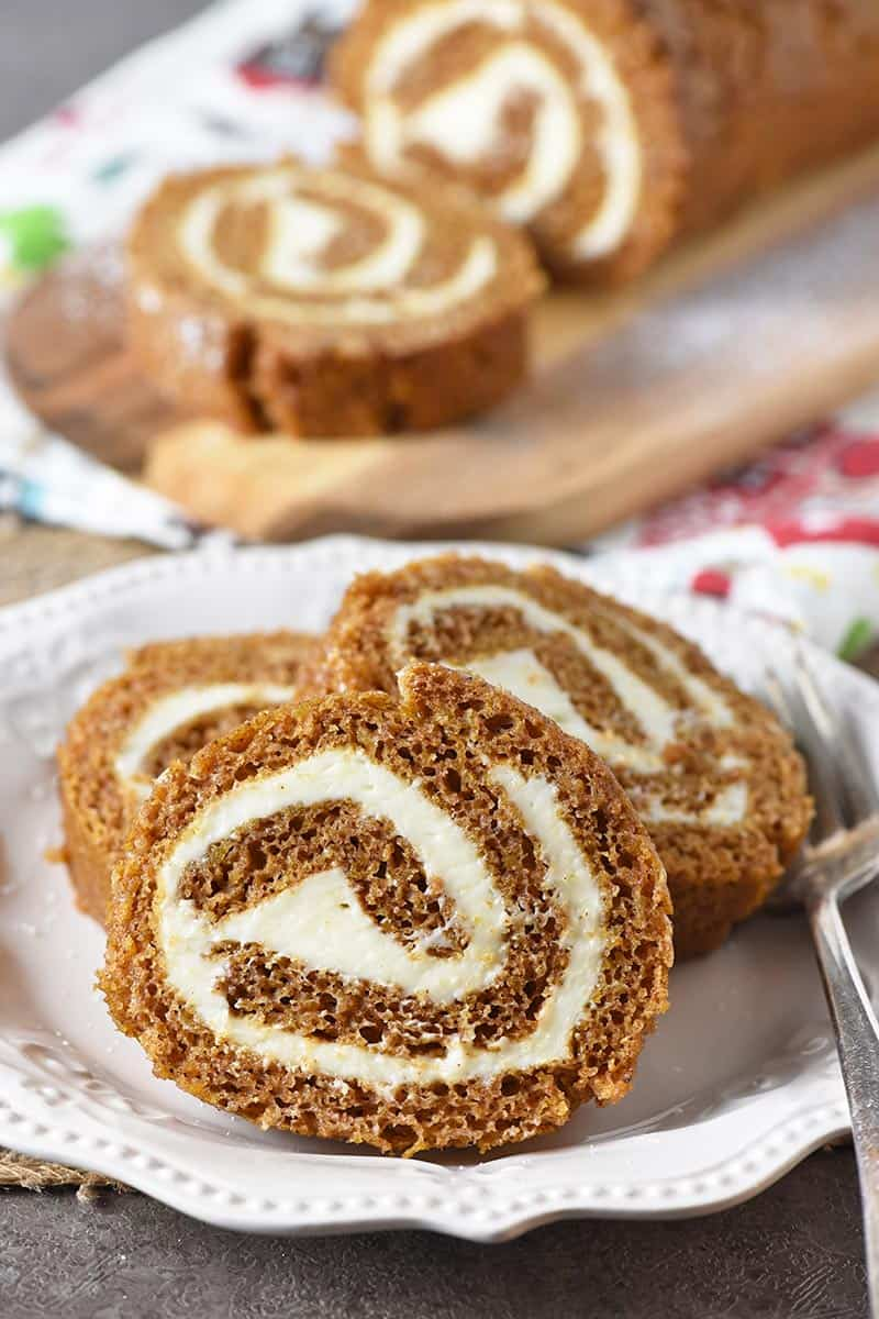 sliced pumpkin roll on an ivory plate for Thanksgiving and Christmas
