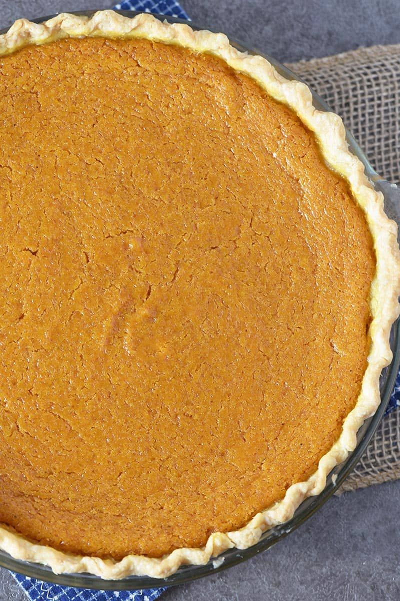 old-fashioned sweet potato pie in baking dish on dark gray countertop