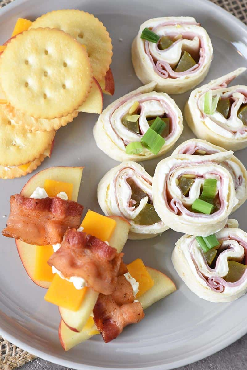 easy appetizer recipes, including pinwheels, bacon wrapped apples and cheese, and crackers and cheese with apples