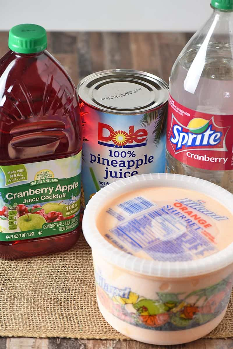 ingredients for making orange sherbet punch recipe, including pineapple juice, cranberry apple juice, Cranberry Sprite, and orange sherbet
