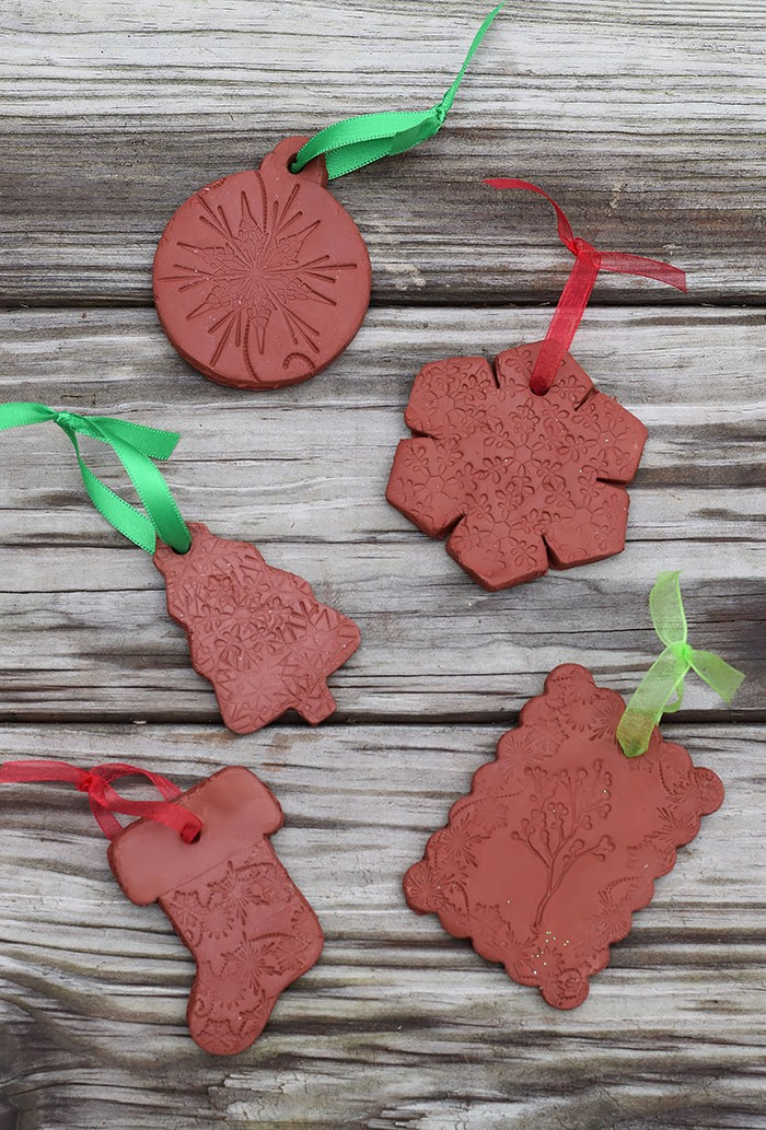 Use Air-Dry Clay, Christmas cookie cutters, and acrylic stamps to make the simplest of crafts, Clay Diffuser Ornaments. They're beautifully festive decorations for the Christmas season, and they add a touch of essential oil scents to both your tree and home.