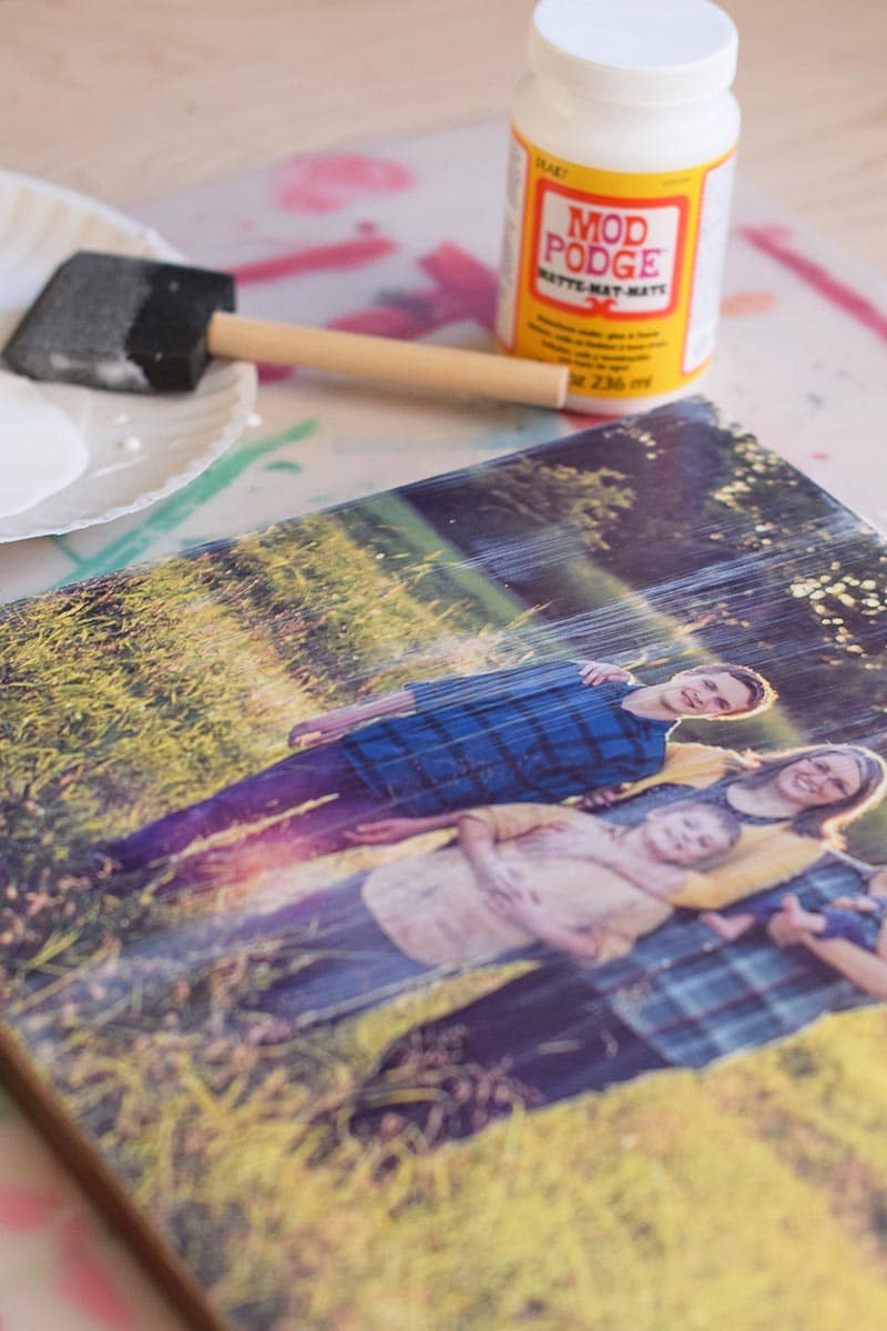 Mod Podge photo to canvas with foam brush