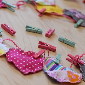 Decorate for Valentine's Day by making a super easy to sew Valentine's Day heart garland with cheap fat quarters from the fabric store. Makes the sweetest Valentine decoration and a fun craft and sewing project!