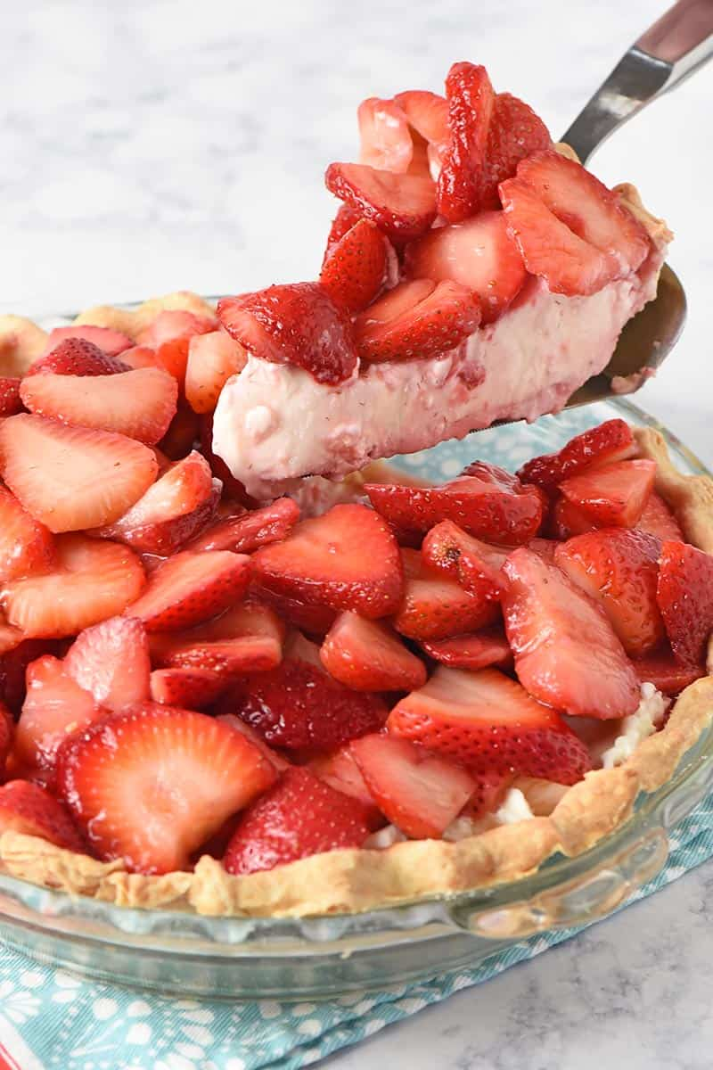 slicing and serving fresh strawberry pie