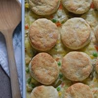 Chicken Pot Pie with biscuits, filled with a medley of vegetables in a creamy delicious sauce, seasoned with sage. Ultimate comfort food dinner recipe.