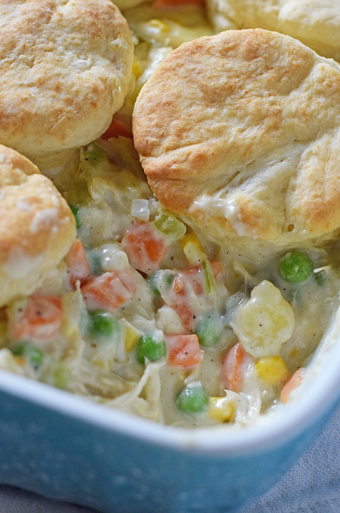 Chicken Pot Pie with biscuits, filled with a medley of colorful vegetables in a creamy sauce. Makes a delicious dinner idea!