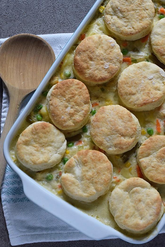 Chicken Pot Pie with Grandma's biscuits, filled with vegetables in a creamy sauce that's seasoned with sage. Ultimate comfort food recipe.