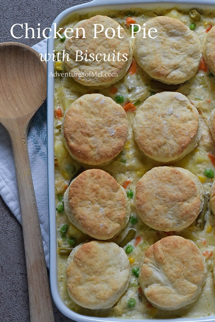 Chicken Pot Pie with Grandma's biscuits, filled with colorful vegetables in a creamy sauce. Ultimate family meal idea.