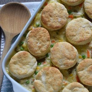 Chicken Pot Pie with Grandma's biscuits, filled with a medley of vegetables in a creamy sauce, seasoned with sage. Ultimate comfort food dinner recipe.